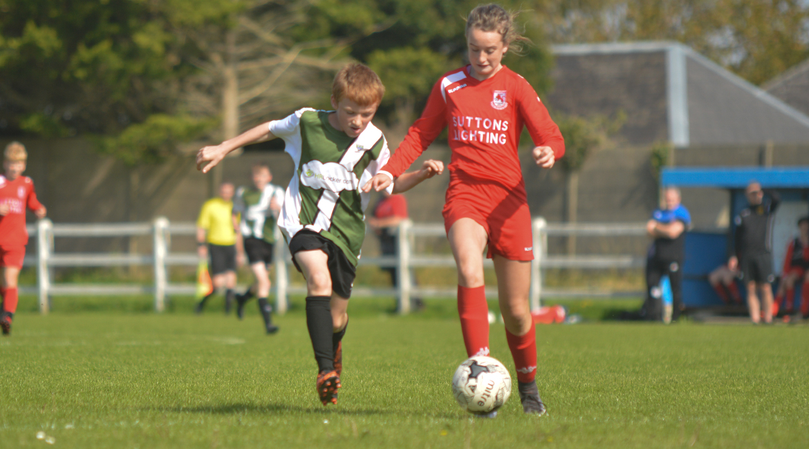 Darren O'Brien challenges for possession in the U13 Division 2 Cup Final between Sporting Ennistymon F.C and Lifford A.F.C in Frank Healy Park.