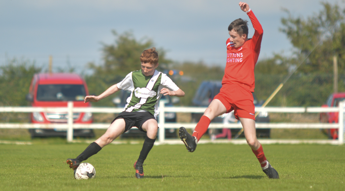 John O'Brien in possession during the U13 Division 2 Cup Final between Sporting Ennistymon F.C and Lifford A.F.C in Frank Healy Park.