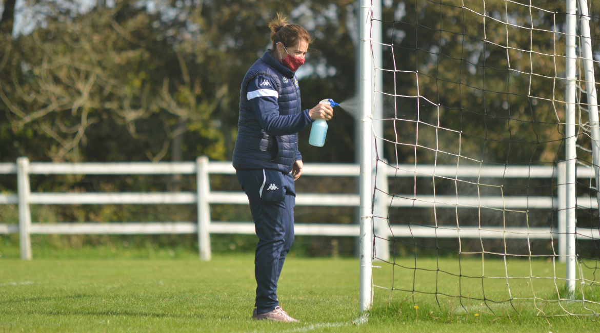 A CSSL Representative sprays the goalpost during the interval of the U13 Division 2 Cup Final between Sporting Ennistymon F.C and Lifford A.F.C in Frank Healy Park.