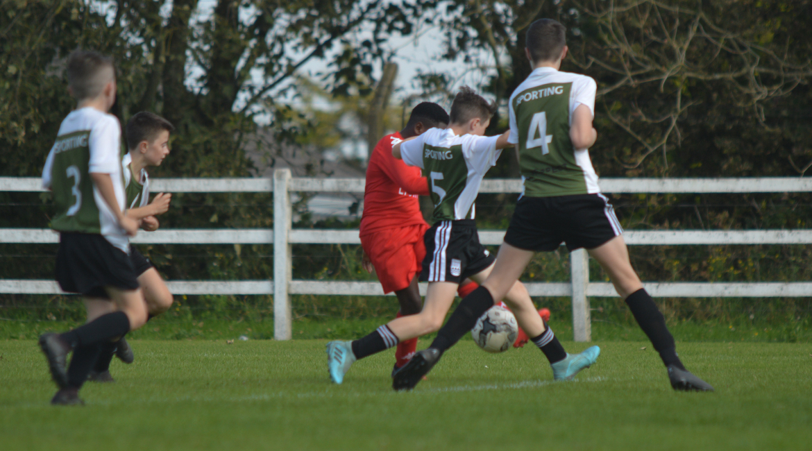 A Lifford AFC player looks to shoot but his effort is blocked by Louis Griffin during the U13 Division 2 Cup Final between Sporting Ennistymon F.C and Lifford A.F.C in Frank Healy Park.