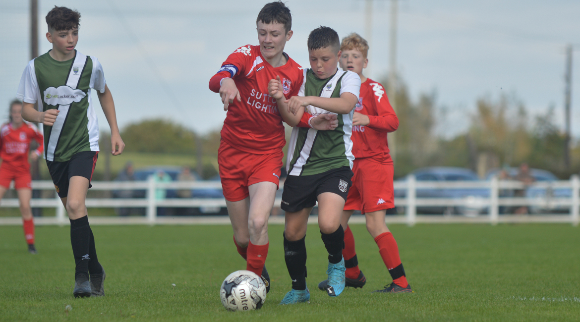 Daniel Brody battles for possession during the U13 Division 2 Cup Final between Sporting Ennistymon F.C and Lifford A.F.C in Frank Healy Park.