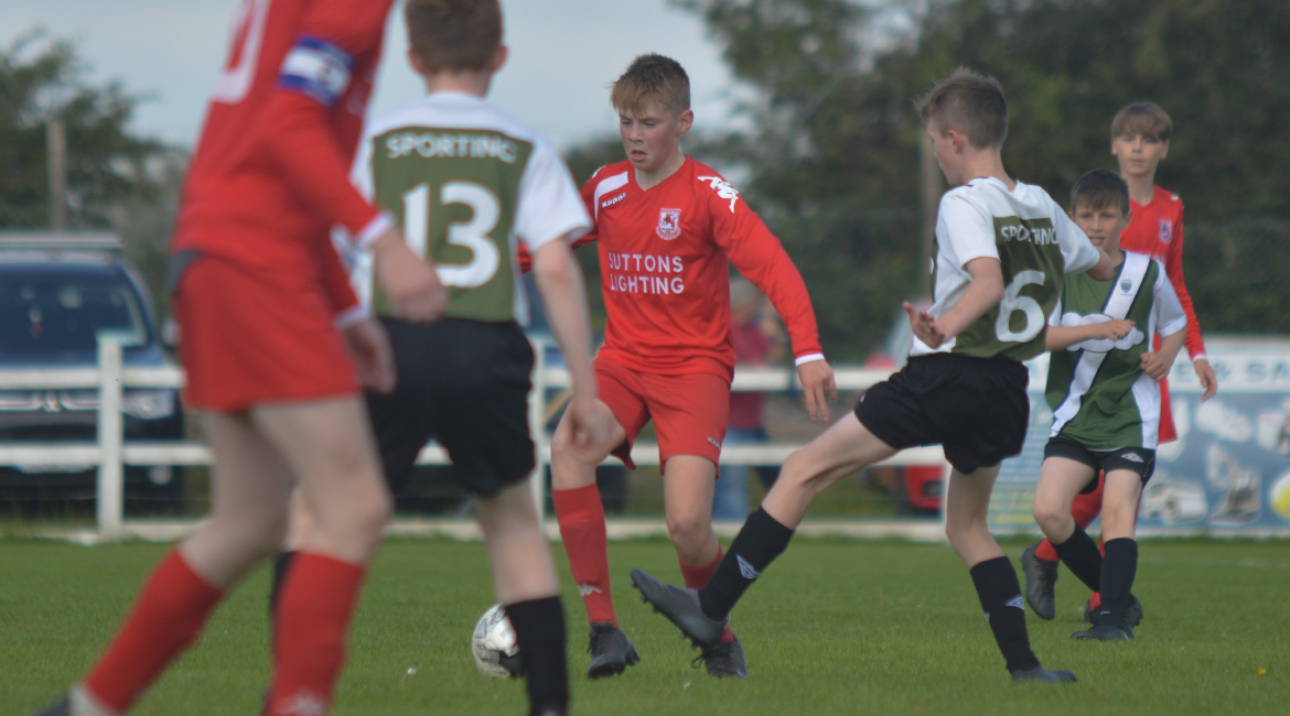 A Lifford AFC player comes under pressure from Jody Scales during the U13 Division 2 Cup Final between Sporting Ennistymon F.C and Lifford A.F.C in Frank Healy Park.