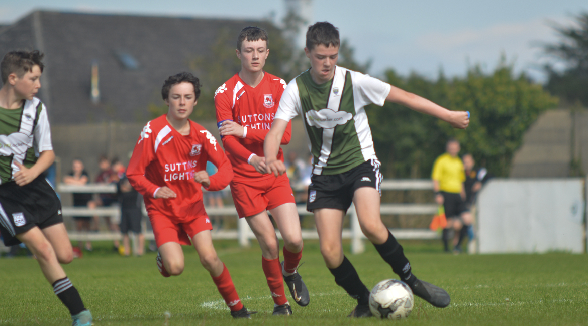 Jack Gallagher in possession during the U13 Division 2 Cup Final between Sporting Ennistymon F.C and Lifford A.F.C in Frank Healy Park.