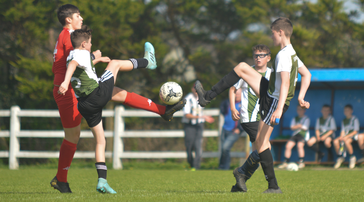 Louis Griffin, Jack Gallagher and a Lifford AFC player challenge for possession during the U13 Division 2 Cup Final between Sporting Ennistymon F.C and Lifford A.F.C in Frank Healy Park.
