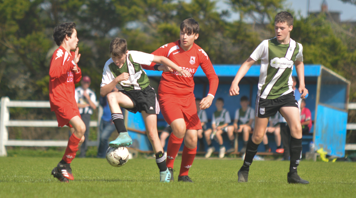 Louis Griffin looks to clear the ball during the U13 Division 2 Cup Final between Sporting Ennistymon F.C and Lifford A.F.C in Frank Healy Park.