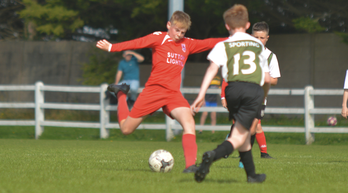 A Lifford AFC player shoots during the U13 Division 2 Cup Final between Sporting Ennistymon F.C and Lifford A.F.C in Frank Healy Park.