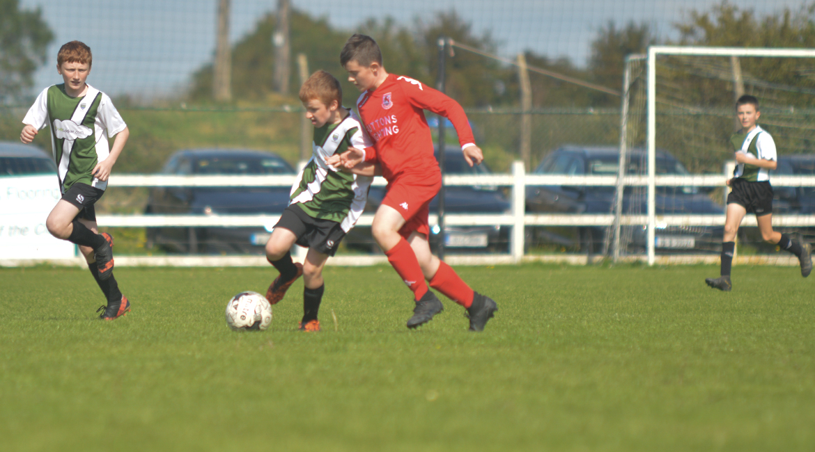 Darren O'Brien challenges for possesion against his Lifford AFC counterpart in the U13 Division 2 Cup Final between Sporting Ennistymon F.C and Lifford A.F.C in Frank Healy Park.